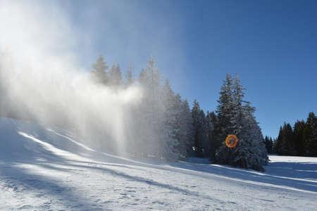 snow grooming machine: Artifical snow in the air, snow gun in action, ski resort Kopaonik, Serbia