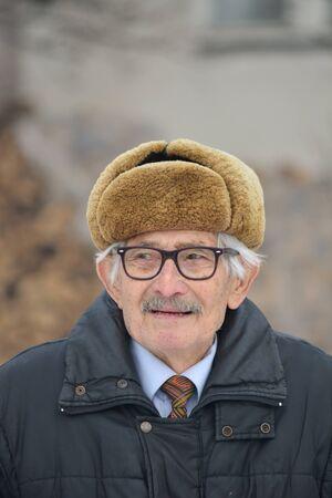 vertical orientation: Portrait of vital elderly man, vertical orientation Stock Photo