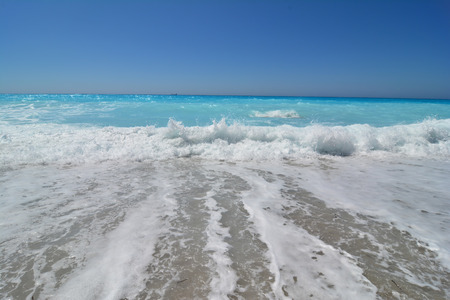 Big waves in a windy day and clean, turquoise water of very famous Kathisma beach, Lefkada island, Greece
