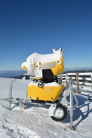 appointed: High power snow gun on the top of the mountain, ready for action, close up view, vertical orientation Stock Photo