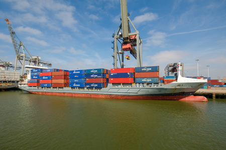 Sea container ship fully loaded in container terminal, Rotterdam harbor. The Port of Rotterdam, the Netherlands.