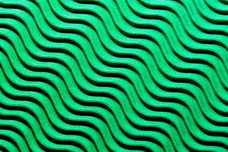Wavy lines with light and shadows in green corrugated cardboard. Banco de Imagens