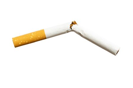 Frontal close up of broken cigarette isolated on white background