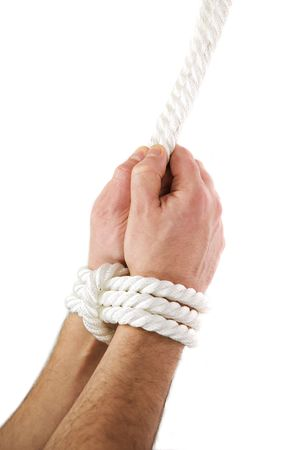 quandary: A mans hands tied of white rope Stock Photo
