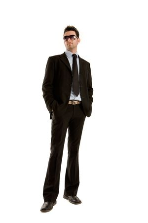 Young businessman whole figure with stylish sunglasses and hands in pocket