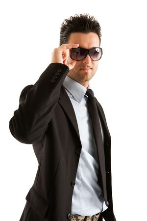 Young businessman with his hand wearing the sunglasses