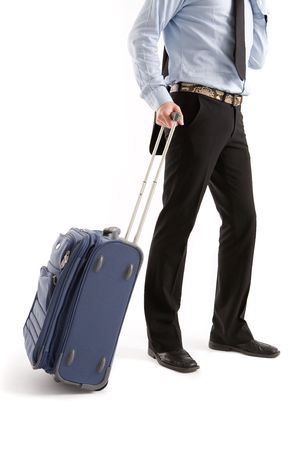 Businessman with suitcase at the airport photo