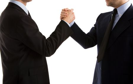 Two businessmen shaking hands in a friendly way to emphasize the agreement initialled. Close up of an agreement signed.