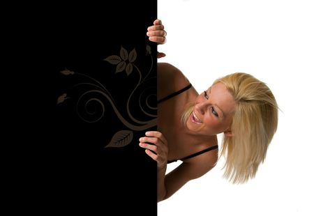 A beautiful and attractive blond hair girl holding a black billboard. Ready to add your own text. Copy-space on a sign or poster. Young girl holding a sign, advertisement or poster. The concept of this picture is: copy-space on a black board or advertisin photo