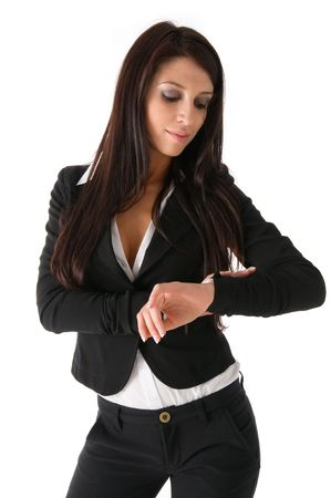 Business woman look at her wrist watch. photo