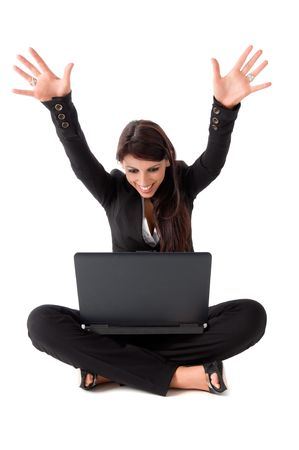 Happy business woman sitting on the ground with laptop.