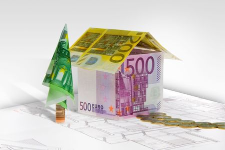 A house made of money on plan. Conceptual image