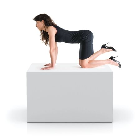 Girl kneeling on a gray 3D cube Stock Photo - 3404985