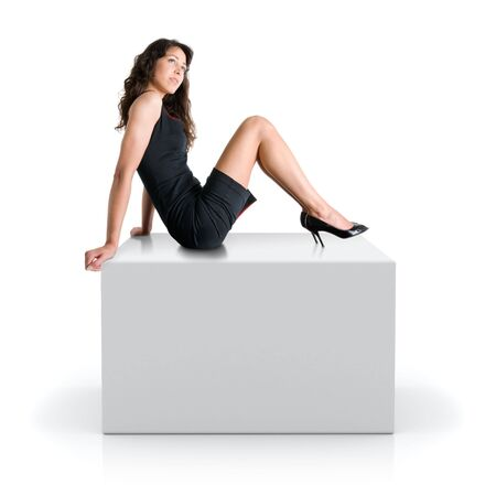 promotion girl: girl sitting on a 3D gray cube Stock Photo