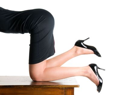 Secretary kneeling on the table in the office Stock Photo