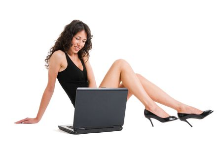 Beautiful and sensual girl working with laptop on the floor