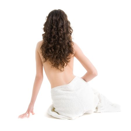 Girl with towel sitting on the floor Stock Photo