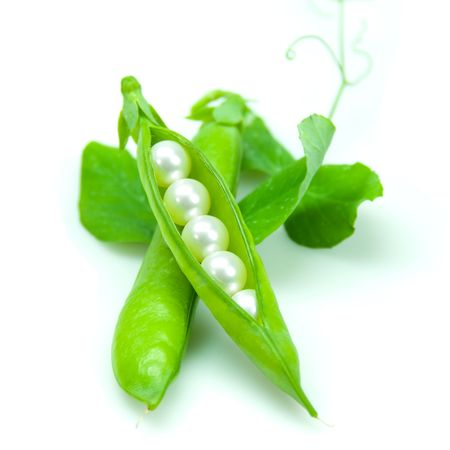 Pea pod containing pearls. Conceptual image