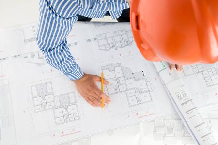 Architect working with technical drawings Stock Photo - 3402453