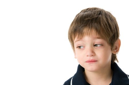 Adorable boy upset isolated on white background