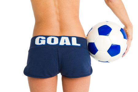 Girl with soccer ball and blue shorts with writing goal Stock Photo