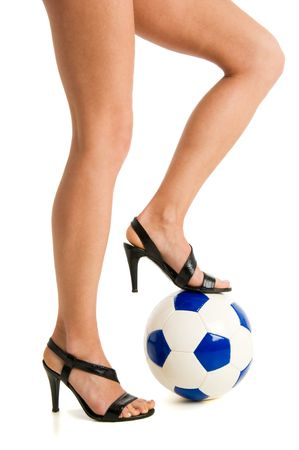 Women bare legs and sandals with soccer ball