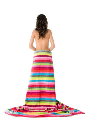 Girl  bare back standing wrapped with colored  stripes towel,  image taken from behind  photo