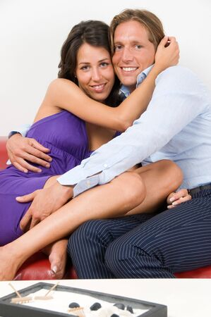 Young happy couple embraced on the sofa Stock Photo - 3646441