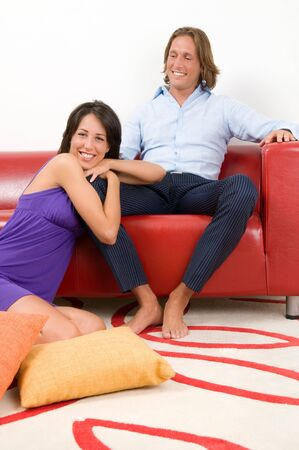 Smiling attractive couple sitting in home. photo