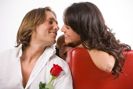 Madly in love man gives a red rose to his beloved Stock Photo - 3646458