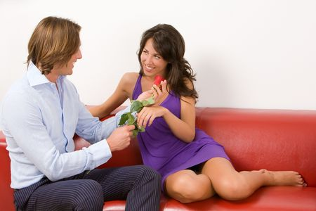 madly: Madly in love man gives a red rose to his girlfriend