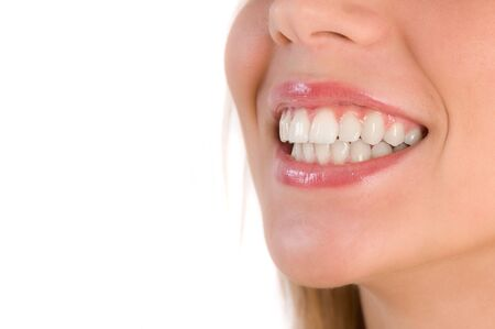Closeup of beautiful smile of young woman. Isolated image on white background