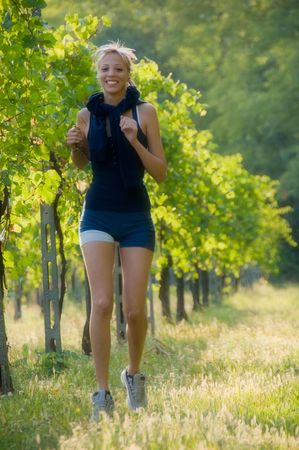 Young woman jogging in the vineyard Stock Photo