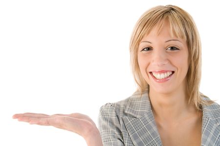 Attractive woman holding and at an imaginary product. Isolated image with white background. Stock Photo