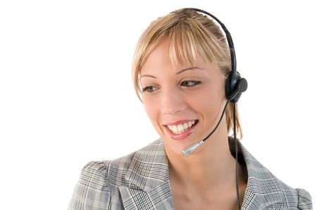 Closeup portrait of a happy pretty executive with headset. Isolated on white background