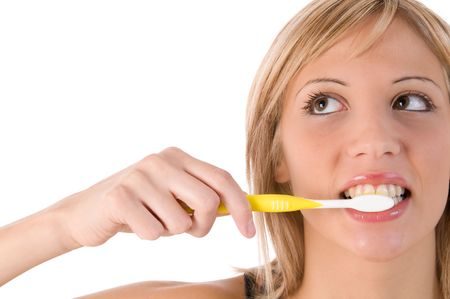 Young blond woman with toothbrush. Isolated image on white background