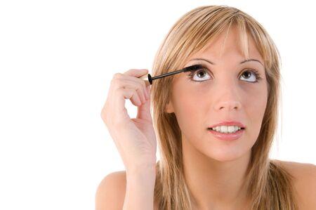 Beautiful girl applying mascara on the eyelashes  photo