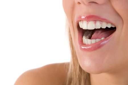 Closeup of beautiful young woman laughing with beautiful teeth