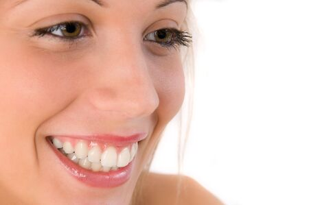 Closeup portrait of a smiling beautiful girl with brown eyes