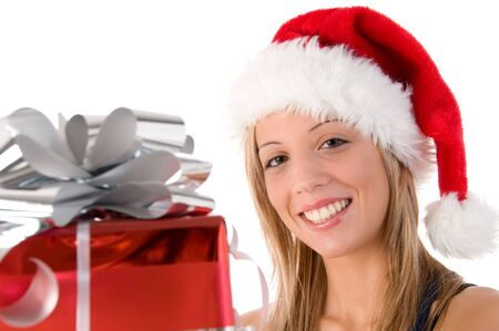 Closeup portrait of a beautiful woman dressed as Santa and holding a gift isolated on white background Stock Photo