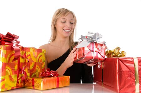 Beautiful young woman opening the colorful gifts photo