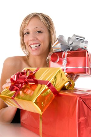 Blond smiling girl offers xmas gifts photo