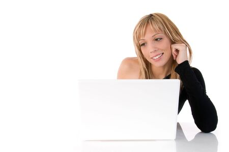 Closeup portrait of a happy young woman using laptop. On white background photo