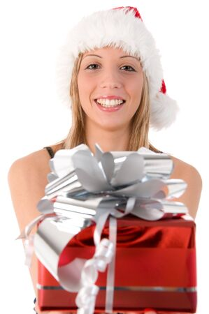 Closeup portrait of a beautiful woman dressed as Santa and holding a gift isolated on white background photo