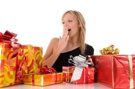 Beautiful blonde girl looks many colorful gifts. Isolated image on white background photo
