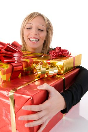Young  smiling woman embraces Christmas gifts photo