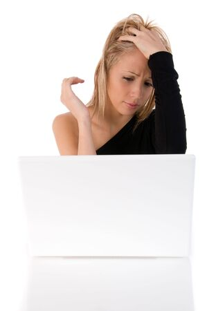 Closeup portrait of a young woman worried using laptop.Isolated on white background photo