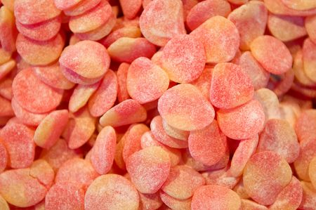 Close up of red and orange jelly beans background Stock Photo