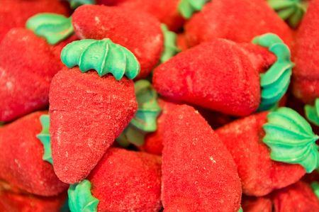 Background candies shaped strawberry
