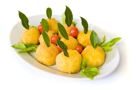 Rice meatballs decorated with cherry tomatoes, celery and bay laurel photo